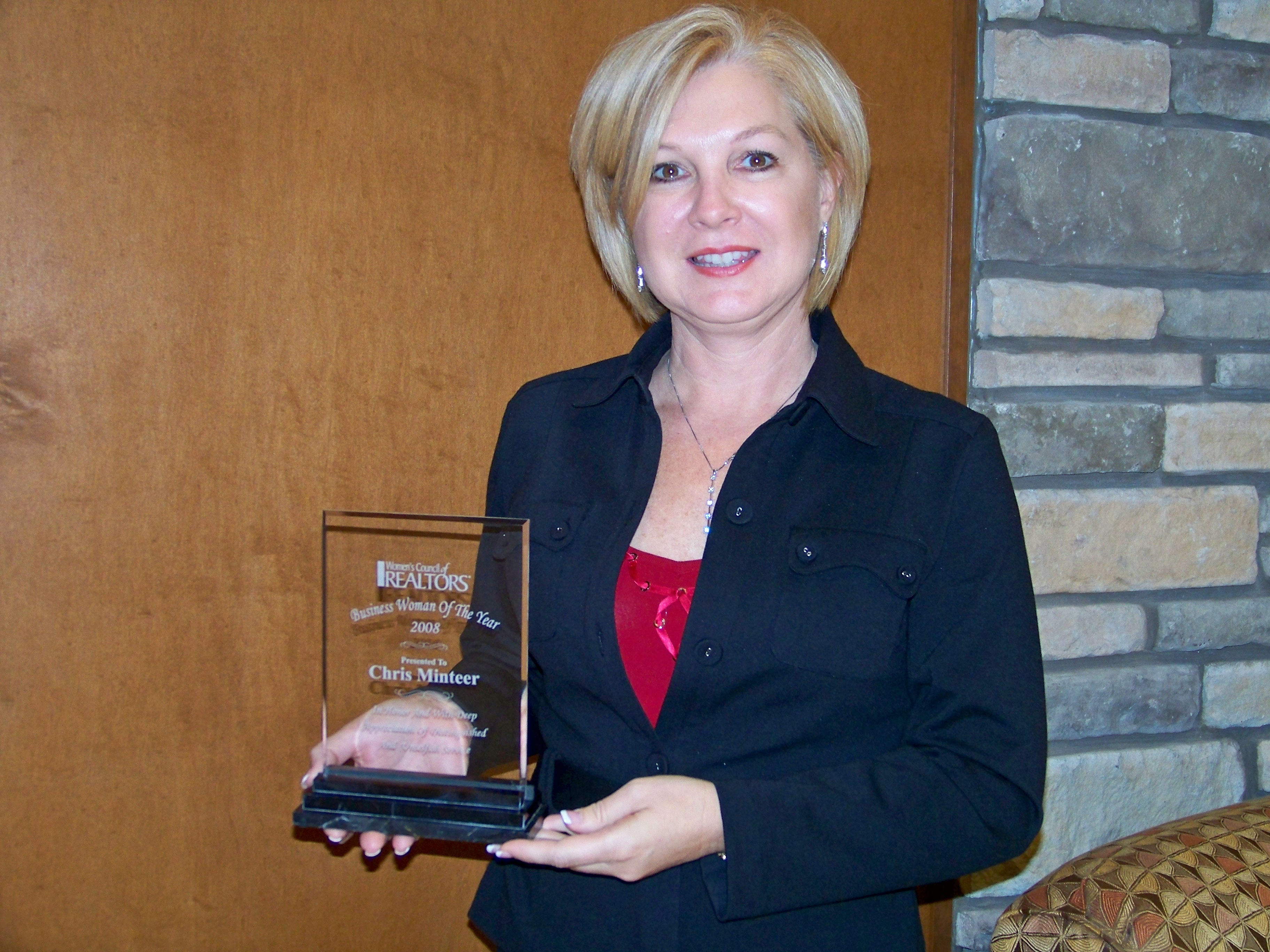 """Chris Minteer holding her """"Business Woman of the Year"""" Award!"""